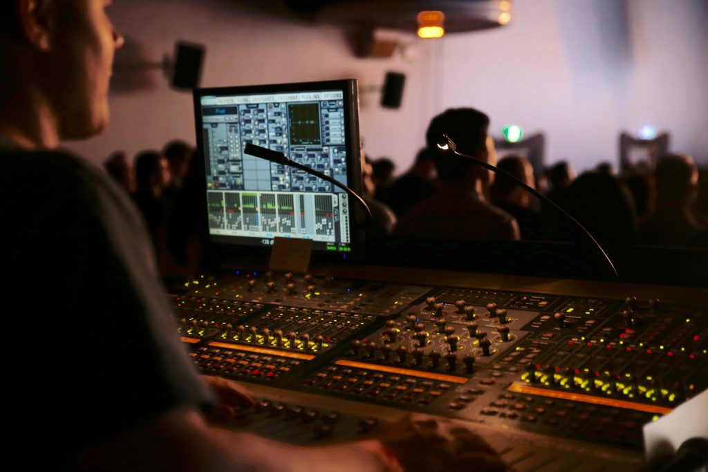 Man in front of a mixing console.