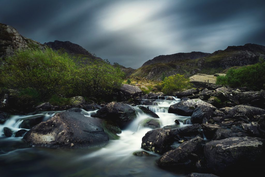 A time-lapse picture of a stream in the Welsh mountains. Photo by Kirk Schwarz on Unsplash.