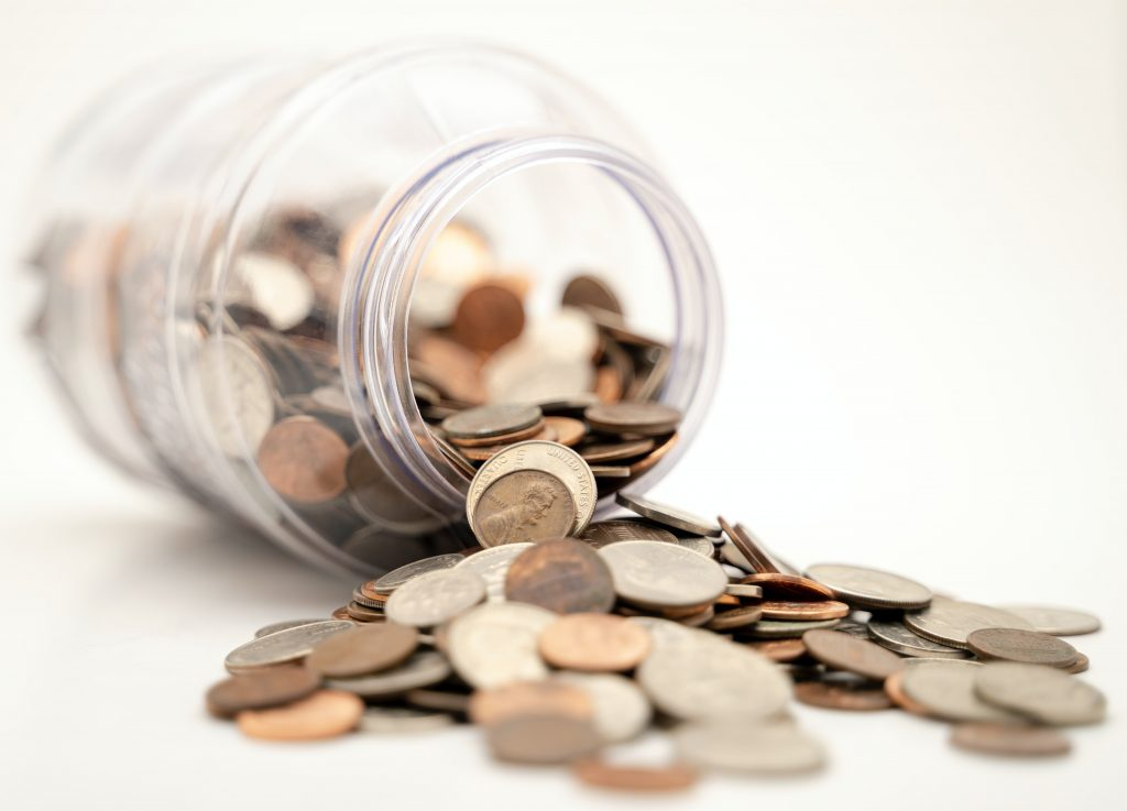 Money spilling out of a jar